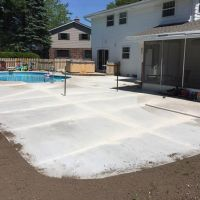 large concrete patio with pool